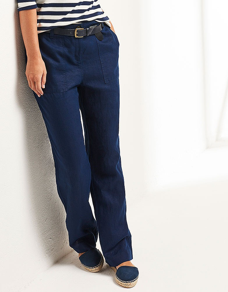 Just right for dressing up with a blouse or going casual with a tee, our soft and drapey Shoreline Linen makes a fresh appearance in these updated trousers. Contoured waist with hidden trouser hook closure. A bit wider leg gives a more luxurious look to a traditional trouser design. Classic Fit with a natural rise to sit right at the waist. Pure linen.